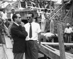 Niemeyer, with hand on chin, inspects the site of an office block in Rio in 1950.