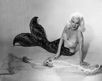 Mamie Van Doren Lying on Ground in Mermaid Suit